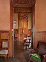 A rich, wood patina links the sitting rooms, with their floral marquetry panelling and parquet flooring. The furniture was designed by Gaspar Homar