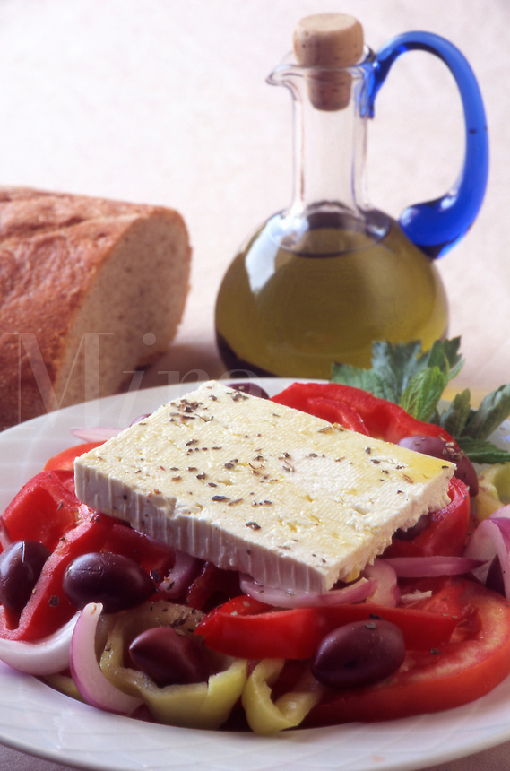 A fresh Greek Salad (Horiatiki) and small bottle of Cretan Olive Oil.  Crete. Greece.