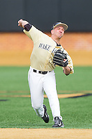 Joey Rodriguez (7) of the Wake Forest Demon Deacons makes a throw to first base during infield practice prior to the game against the Marshall Thundering Herd at Wake Forest Baseball Park on February 17, 2014 in Winston-Salem, North Carolina.  The Demon Deacons defeated the Thundering Herd 4-3.  (Brian Westerholt/Four Seam Images)