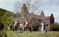 Ballwick Estate. Family on horses in front of the estate.