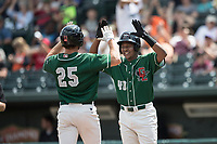 Great Lakes Loons outfielder Carlos Rincon (40) celebrates with teammate Cody Thomas (25) after a home run against the Bowling Green Hot Rods during the Midwest League baseball game on June 4, 2017 at Dow Diamond in Midland, Michigan. Great Lakes defeated Bowling Green 11-0. (Andrew Woolley/Four Seam Images)