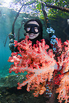 Kitty smiling, snorkeler happy with her find of rainbow colored soft coral