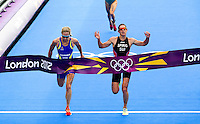 04 AUG 2012 - LONDON, GBR - Nicola Spirig (SUI) of Switzerland (right) beats Lisa Norden (SWE) of Sweden (left) to the line at the end of the women's London 2012 Olympic Games Triathlon in Hyde Park in London, Great Britain (PHOTO (C) 2012 NIGEL FARROW)