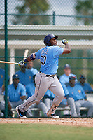 Tampa Bay Rays right fielder Moises Gomez (70) follows through on a swing during an Instructional League game against the Pittsburgh Pirates on October 3, 2017 at Pirate City in Bradenton, Florida.  (Mike Janes/Four Seam Images)