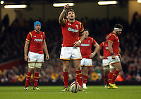 Dan Biggar of Wales checks the air before taking a kick during the RBS 6 Nations Championship rugby game between Wales and Scotland at the Principality Stadium, Cardiff, Wales, UK Saturday 13 February 2016