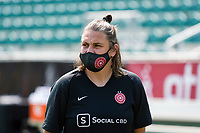 CARY, NC - SEPTEMBER 12: Portland Thorns goalkeeping coach Nadine Angerer spends time on the field before a game between Portland Thorns FC and North Carolina Courage at WakeMed Soccer Park on September 12, 2021 in Cary, North Carolina.
