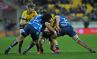 Hurricanes' Du'Plessis Kirifi is tackled during the Super Rugby Aotearoa match between the Hurricanes and Blues at Sky Stadium in Wellington, New Zealand on Saturday, 18 July 2020. Photo: Dave Lintott / lintottphoto.co.nz