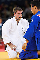 29 JUL 2012 - LONDON, GBR - Colin Oates (GBR) (left) of Great Britain and Cho Jun-Ho (KOR) of South Korea recover during a break in their men's -66kg category repechage contest at the London 2012 Olympic Games judo at the ExCel Exhibition Centre in London, Great Britain (PHOTO (C) 2012 NIGEL FARROW)