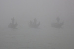 Three gondolas in the fog on the Grand Canal, Venice, Italy.