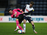20th April 2021; Deepdale, Preston, Lancashire, England; English Football League Championship Football, Preston North End versus Derby County; Tom Barkhuizen of Preston North End wins the ball from Craig Forsyth of Derby County