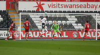 Pictured: Jesse Lingard of England (10) heads the ball over the bar and Connor Roberts goalkeeper for Wales (C). Monday 19 May 2014<br />