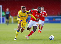 10th October 2020; The County Ground, Swindon, Wiltshire, England; English Football League One; Swindon Town versus AFC Wimbledon; Anthony Grant of Swindon Town challenges Terell Thomas of AFC Wimbledon