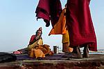 Holy man smokes at a ghat in Varanasi, Uttar Pradesh, India.