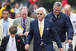 May 16, 2015: Trainer Bob Baffert follows one of his two Preakness contenders, American Pharoah, on the walk from barn to track before the Preakness. American Pharoah, Victor Espinoza up, wins the Preakness Stakes at Pimlico Race Course in Baltimore, MD. Trainer is Bob Baffert; owner is Ahmed Zayed. Joan Fairman Kanes/ESW/CSM