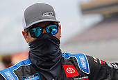 HAMPTON, GEORGIA - JUNE 06: Stewart Friesen, driver of the #52 Halmar Racing to Beat Hunger Toyota, waits on the grid prior to the NASCAR Gander Outdoors Truck Series Vet Tix Camping World 200 at Atlanta Motor Speedway on June 06, 2020 in Hampton, Georgia. (Photo by Chris Graythen/Getty Images)