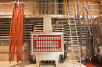 The winery control panel. It shows each of the fermentation tanks in white and on each tank you can read the temperature of the wine. To the left, pipes used for pumping wine.  Domaine E Guigal, Ampuis, Cote Rotie, Rhone, France, Europe