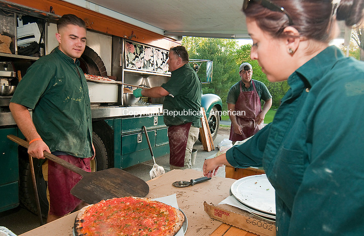 WATERTOWN, CT--051415JS18- Workers from the Big Green Pizza Truck, from left, Jay Tranberg; Chris Beauton; Wade Haskins and Caitlyn Nunes, made and served pizza during their appearance at during the Greater Waterbury Campership Fund's  fundraiser Thursday at the Waterbury YMCA's Camp Mataucha in Watertown.<br /> Jim Shannon Republican-American