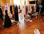 Racks of cloths for the models sit backstage at the Salvation Army Women's Auxiliary Luncheon and Fashion Show at the River Oaks Country Club Tuesday April 13,2010. (Dave Rossman Photo)