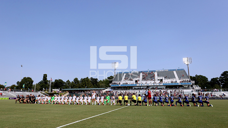 CARY, NC - SEPTEMBER 12: The match officials, starters for the North Carolina Courage, and entire match delegation for the Portland Thorns FC during the playing of the national anthem before a game between Portland Thorns FC and North Carolina Courage at Sahlen's Stadium at WakeMed Soccer Park on September 12, 2021 in Cary, North Carolina.