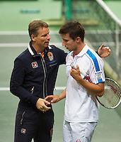 02-02-14,Czech Republic, Ostrava, Cez Arena, Davis Cup Czech Republic vs Netherlands, Igor Sijsling(NED) is being congratulated bij captain Jan Siemerink<br /> Photo: Henk Koster