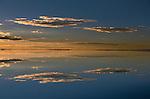 Dawn reflects over the Salar de Uyuni (salt flat)