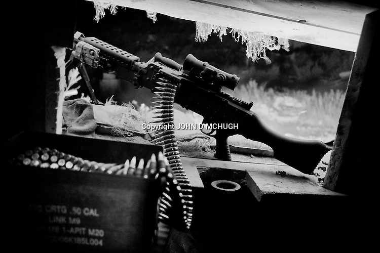 Guns and ammunition are seen at Checkpoint 2.5, beside Saw village, in Kunar province, 02 Dec 2011. (John D McHugh)