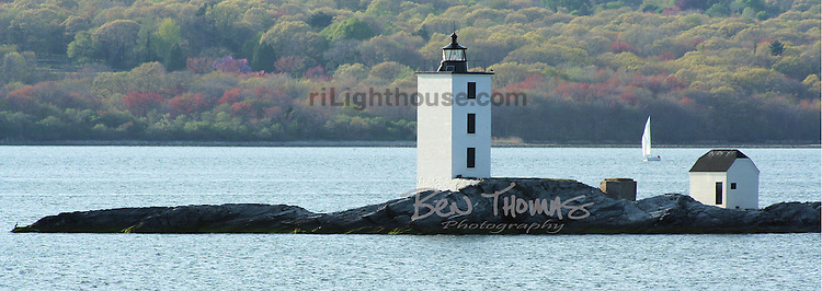 A late afternoon sail by Dutch Island Light as summer comes to an end.