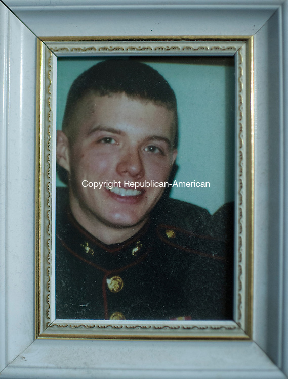 WATERBURY, CT- 23 May 2016-052316EC15-  Jay Cooling's friend and fellow Marine, 21-year-old Corporal Jordan Pierson of Milford, died while fighting in Iraq. This picture hangs in Cooling's home. Erin Covey Republican-American