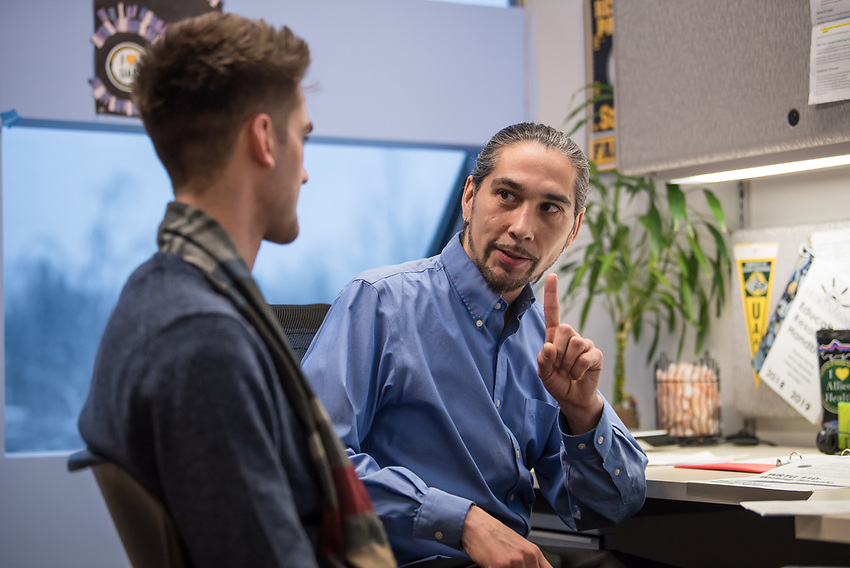 First Year Student Advisor Quentin Simeon talks with Shane Mueller in the First Year Advising Center in UAA's Professional Studies Building.
