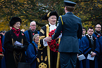 Pictured: he Lord Mayor for York, Councillor Keith Orrell is handed a wreath. Sunday 11 November 2018<br /> Re: Commemoration for the 100 years since the end of the First World War on Remembrance Sunday at York Minster, England, UK