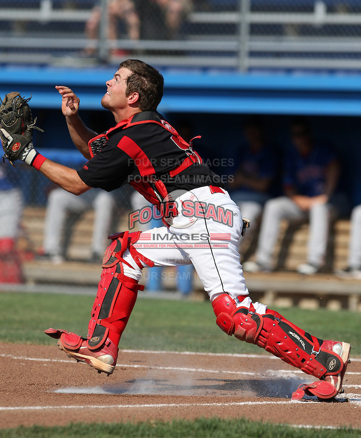 Batavia Muckdogs catcher Casey Rasmus #5 catches a bunt pop up during a game against the Auburn Doubledays at Dwyer Stadium on July 17, 2011 in Batavia, New York.  Batavia defeated Auburn 8-3.  (Mike Janes/Four Seam Images)