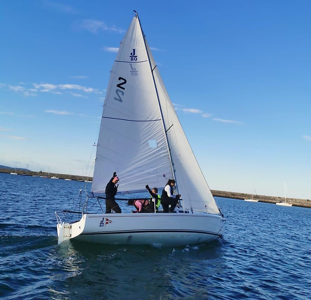 The J/80 Jeorgette team from the Royal St. George Yacht Club out training in their home waters of Dun Laoghaire Harbour