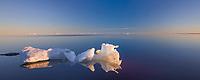 Iceberg floats in the Beaufort Sea off the shore of Barter Island, Kaktovik, Alaska