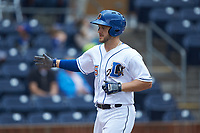 Adam Moore (15) of the Durham Bulls returns to the dugout after hitting a solo home run against the Buffalo Bison at Durham Bulls Athletic Park on April 25, 2018 in Allentown, Pennsylvania.  The Bison defeated the Bulls 5-2.  (Brian Westerholt/Four Seam Images)