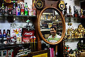 61 year old Antique shop owner, Tony Sarreal poses for a photo in his store, Angel Spirits in Cubao Expo in Quezon city in Manila, Philippines. Photo: Sanjit Das