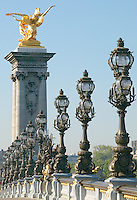 The Art Nouveau street lights and gilded sculpture on the Pont Alexander III which spans the river Seine, Paris, France