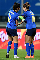 Barbara Bonansea helps her team mate Cristiana Girelli of Italy to wear the captain armband during the Women s EURO 2022 qualifying football match between Italy and Denmark at stadio Carlo Castellani in Empoli (Italy), October, 27th, 2020. Photo Andrea Staccioli / Insidefoto