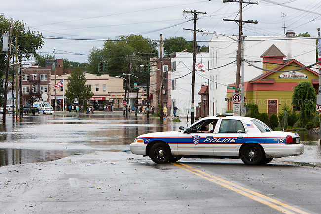 MAMARONECK, NY - AUGUST 28: A village police cruiser blocks vehicular access to flooded Mamaroneck Avenue in the Village of Mamaroneck, New York on Sunday August 28, 2011 in the aftermath of Hurricane Irene.
