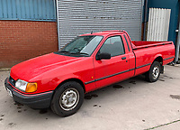 BNPS.co.uk (01202 558833)<br /> Pic: HampsonAuctions/BNPS<br /> <br /> Pictured: 1992 Ford P100 Pickup.<br /> <br /> Since the 1990s, Geoff Barlow, 46, has collected dozens of classic cars from an Escort Mexico replica to several types of Transit, Cortina, and Sierra.<br /> <br /> However, he still regrets selling the first car which inspired his passion, a 1980 Escort Mark 2 he bought from his sister in 1992.  <br /> <br /> Geoff's fascination with Fords gathered pace in the last decade and he 'lost control,' buying as many Fords as he came across and saving them from disrepair.
