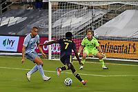 KANSAS CITY, KS - OCTOBER 11: #22 Winston Reid and #29 Tim Melia of Sporting Kansas City keep their eye on #7 Abu Danladi of Nashville SC as he tries to get a shot on goal during a game between Nashville SC and Sporting Kansas City at Children's Mercy Park on October 11, 2020 in Kansas City, Kansas.