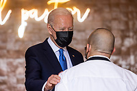"""United States President Joe Biden speaks to workers as he picks up tacos during a visit to Las Gemelas Restaurant  in Washington, DC, USA, 05 May 2021.United States President Joe Biden picks up tacos during a visit to Las Gemelas Restaurant  in Union Market to highlight the successes of the American Rescue Plan (ARP) in Washington, DC, USA, 05 May 2021.  Las Gemelas is a beneficiary of relief funding from the pilot program Restaurant Revitalization Fund.  """"The ARP's Restaurant Revitalization Fund provides $28.6 billion in direct relief to restaurants and food and beverage establishments, and prioritizes restaurants that are women-owned, veteran-owned, and owned by other socially and economically disadvantaged individuals.""""<br /> CAP/MPI/RS<br /> ©RS/MPI/Capital Pictures"""