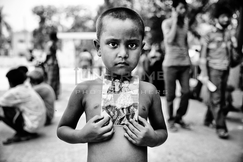on 2nd May 2013, one little girl came to me and requested me to take a picture with her mother. I was little bit in a rush. I asked where her mother were, then I would hane taken the picture. She held an image up to her chest and again asked to take the picture.  Adhar Chandra High School, Savar, near Dhaka, Bangladesh