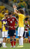FORTALEZA - BRASIL -04-07-2014. Foto: Roberto Candia / Archivolatino<br /> James Rodriguez (#10) jugador de Colombia (COL) conversa con Dani Alves (#2) y David Luiz (#4) jugadores de Brasil (BRA) después del partido de los cuartos de final por la Copa Mundial de la FIFA Brasil 2014 jugado en el estadio Castelao de Fortaleza./ James Rodriguez (#10) player of Colombia (COL) talks with Dani Alves (#2) y David Luiz (#4) players of  Brazil (BRA) after the match of the Quarter Finals for the 2014 FIFA World Cup Brazil played at Castelao stadium in Fortaleza. Photo:  Roberto Candia / Archivo Latino<br /> VizzorImage PROVIDES THE ACCESS TO THIS PHOTOGRAPH ONLY AS A PRESS AND EDITORIAL SERVICE IN COLOMBIA AND NOT IS THE OWNER OF COPYRIGHT; ANOTHER USE IS REPONSABILITY OF THE END USER. NO SALES, NO MERCHANDASING. ALL COPYRIGHT IS ARCHIVOLATINO