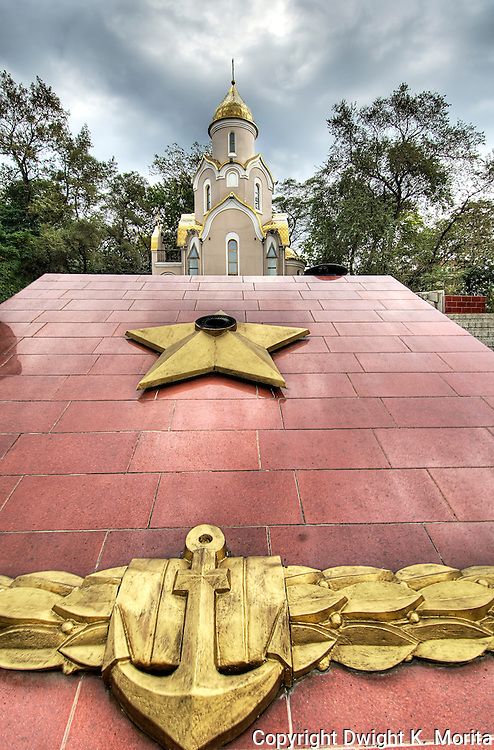 A dramatic view of the War Memorial with chapel in background, Vladivostok, Russia