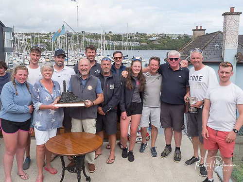 Annamarie Fegan is presented with the KYC Fastnet Trophy by Rear Commodore Tony Scannell after Nieulargo won Kinsale's Fastnet Race in August 2020
