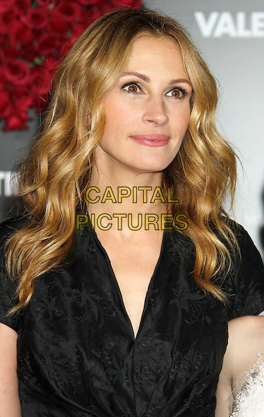 """JULIA ROBERTS .""""Valentine's Day"""" Los Angeles Premiere - arrivals held at Grauman's Chinese Theatre, Hollywood, California, USA, .8th February 2010. .portrait headshot black wavy hair .CAP/ADM/MJ.©Michael Jade/AdMedia/Capital Pictures."""