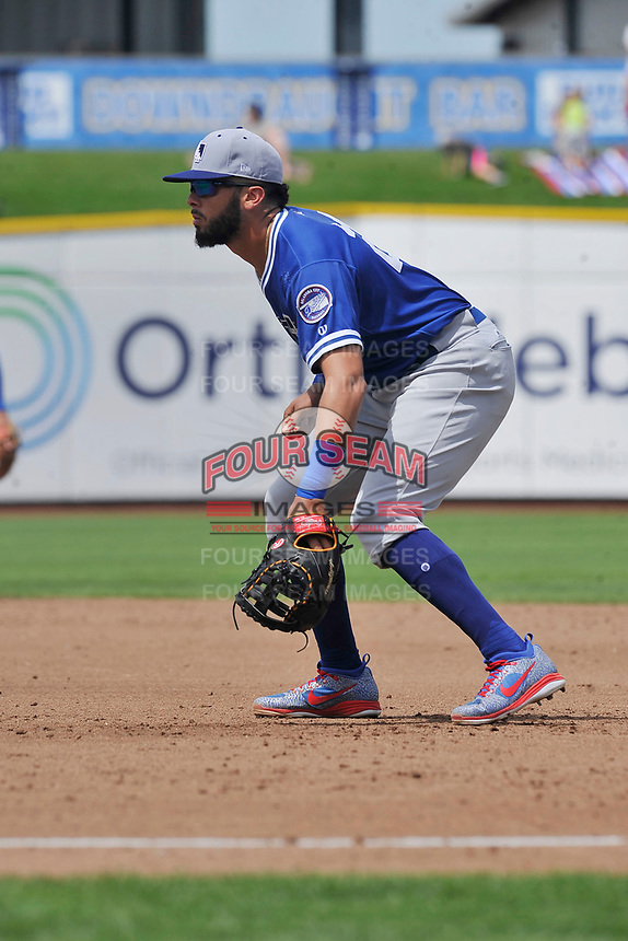 Oklahoma City Dodgers first baseman Edwin Rios (24) in action against the Omaha Storm Chasers at Werner Park on June 24, 2018 in Omaha, Nebraska. Omaha won 8-0.  (Dennis Hubbard/Four Seam Images)