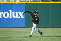 Gorkys Hernandez (9) of the Charlotte Knights makes a throw from the outfield during fielding practice prior to the game against the Gwinnett Braves at BB&T Ballpark on April 16, 2014 in Charlotte, North Carolina.  The Braves defeated the Knights 7-2.  (Brian Westerholt/Four Seam Images)