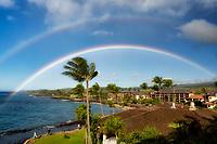 View of ocean front resorts with rainbow in Poipu, Kauai, Hawaii