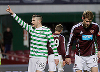 28.11.2012 Edinburgh, Scotland. Gary Hooper and Marius Zaliukas in action during the Scottish Premier League game between Heart of Midlothian and Celtic from Tynecastle Stadium.